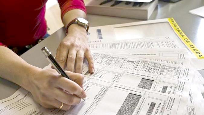 Cumplimentando impresos ayuda deducciones